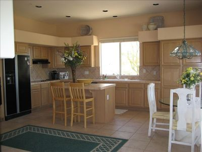Kitchen that is supplied with pots, pans, dishes and glassware