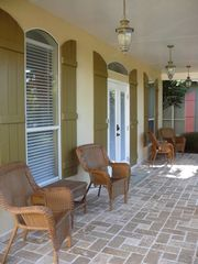 Emerald Shores house photo - Large travertine tiled porches