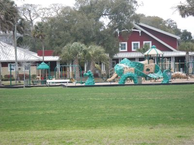 Playground across street with basket ball indoor and outdoor courts, tennis, etc