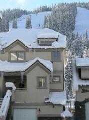 Copper Mountain townhome photo - Front of condo with own heated garage and entrance, Super Bee lift in background