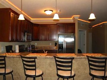 Entertaining is easy in the gorgeous kitchen. Recessed lights in the crown mold.