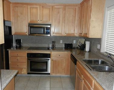 Stainless steel appliances and granite countertops in the kitchen.
