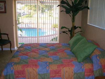 Second bedroom has queen bed & opens to pool.