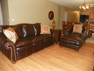 San Tan Valley house photo - Lovely faux leather brown pull out couch and chair with otterman