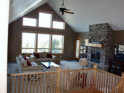 Another view of great room.  We love the floor to ceiling stone fireplace!