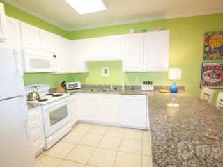 Orange Beach condo photo - Spacious kitchen with granite countertops