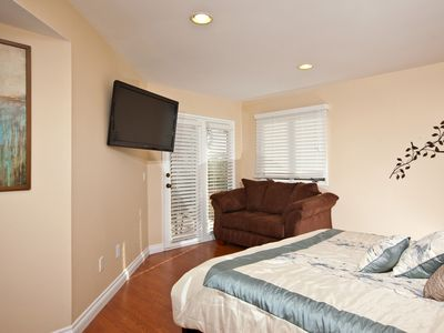 MASTER BEDROOM W/ FLAT TV AND LOVE SEAT