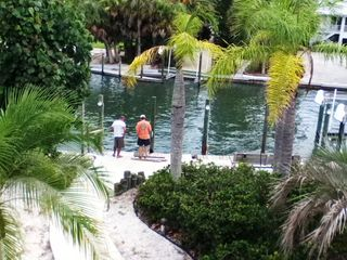 Boca Grande house photo - Deck view of Galleon Cove, Dock and boat lifts.