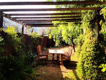 Have an al fresco dinner in your orchard under the green arbor cover in vines