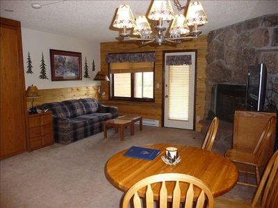 Large fireplace, flat screen TV, walk out to patio