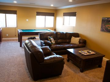 Mancave/bedroom w/fold out queen, game table, bar w/fridge & sink, TV, blu-ray