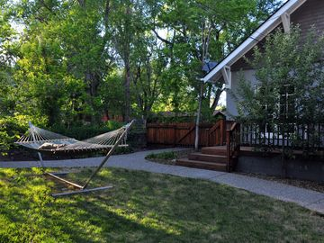 Relax in the park-like backyard in a hammock-for-two