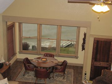 View of dining and lake from loft