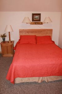 Red River cabin rental - Second floor queen bedroom (opposite side of queen with balcony)