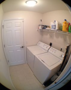 laundry area with door to garage where water heater is located