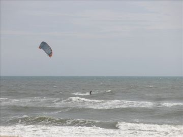 Kiteboarder in front of cabana
