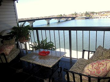 Patio right over water, boat stall below. Watch fireworks from right here.