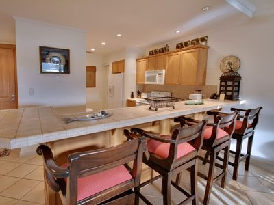 Fully Equipped kitchen and breakfast bar area, perfect for socializing