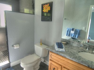 Pompano Beach house rental - A Large Master Bathroom With Black Marble Tiled Shower.