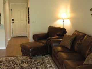 Living Room with new queen sleeper sofa and comfy easy chair.