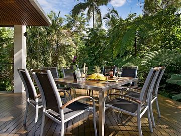 A meal or a cocktail on the rear deck surrounded by tropical vegetation