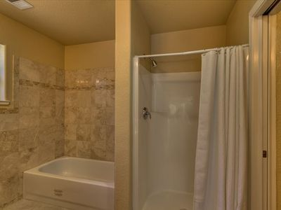 Master bathroom with separate bathtub and shower
