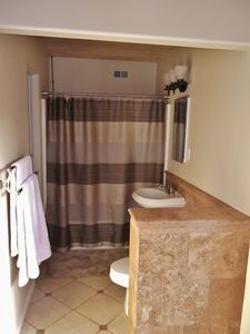 Master bathroom with a separate make-up vanity and direct out-door patio access.