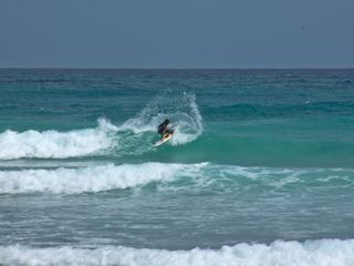 Atlantic Shores apartment photo - Surfing at Freighter's Point, two minutes away from our property.