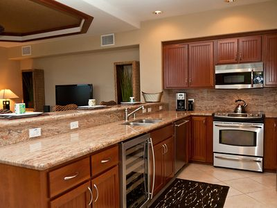 Gourmet Kitchen with GE Monogram Appliances and Granite Countertops
