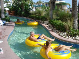 Relax in the lazy river at the Ocean Walk! The tubes are free to use! - Daytona Beach condo vacation rental photo