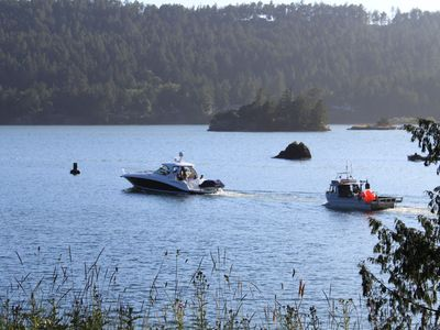 watch the boats pass through the cove
