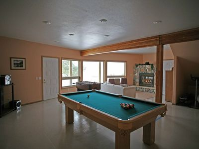 Open basement, complete with full size pool table and fusball table.