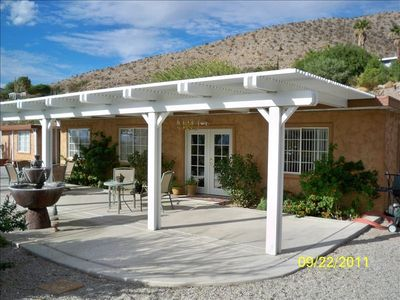 Front of Home with Fountain and views of the mountains and desert.