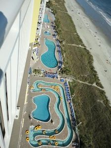 Another view of the giant pool deck from another owners unit.