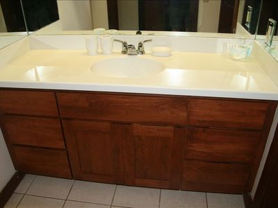 Pecan vanity with corian counter top