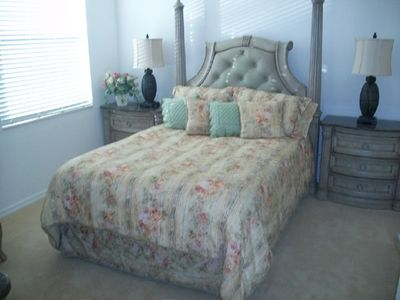 Stunning master bedroom with marble top end table and high end bedding!