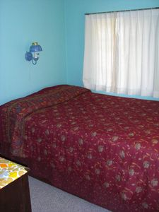 Interlochen cottage rental - Bedroom #3. Corner room with two windows, bed and bureau.