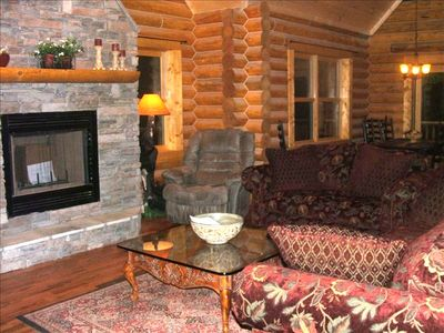 "Combortable great room with 25 foot stacked stone fireplace and 42"" LCD TV"