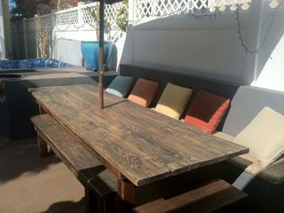 Large outdoor dining table with custom cushions.