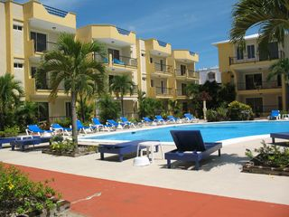 Sosua condo photo - large pool with sun chairs