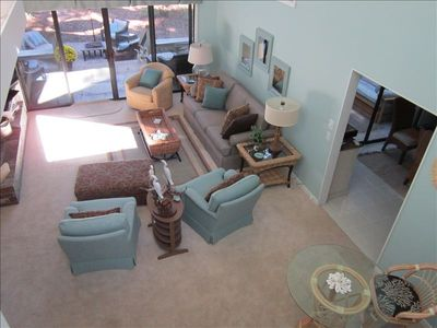 View of large, open living room from above - volume ceilings