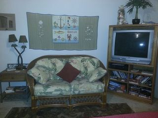Loveseat in living/bedroom area+cableTV/DVD/VCR remotes, complete with 50+movies - Corpus Christi condo vacation rental photo