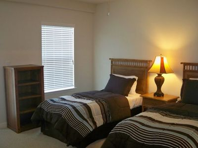Guest Bedroom With 2 Twin Beds and Bath