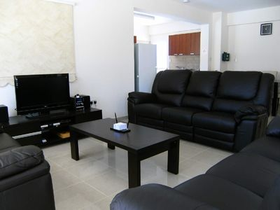 Open plan living area with LCD satellite TV