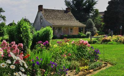 Nestled among exquisite flower gardens this romantic retreat is a must see...