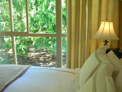 The upper bedroom overlooks the tranquil courtyard, fresh fine linens supplied