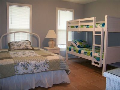 Middle bedroom with a queen and twin bunk beds