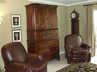 Old Town Scottsdale townhome rental - Leather Recliners and Antique Armoire