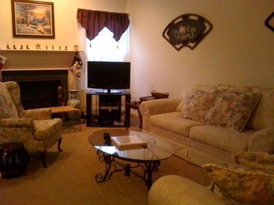 Family Room - Gas fireplace, flat screen cable TV & DVD, cozy couches.