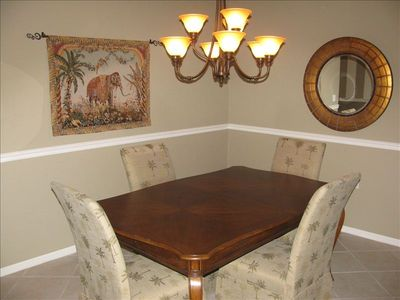 Formal dining shares space with family and kitchen area. Very open floor plan!